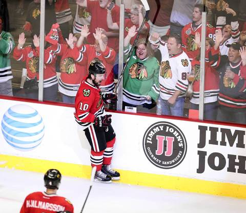 Patrick Sharp celebrates his second period goal against the Kings.
