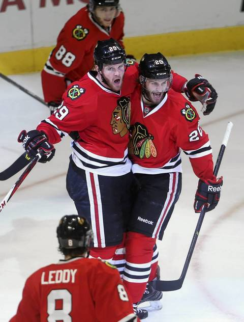 Bryan Bickell and Brandon Saad celebrate Bickell's goal against the Kings in the second period.