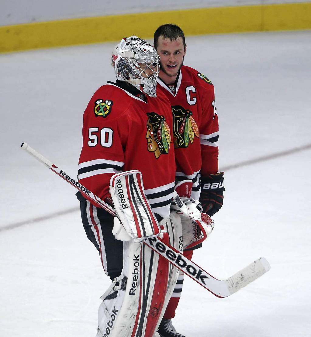 Jonathan Toews thanks Corey Crawford for backing him up in a scuffle in the third period.