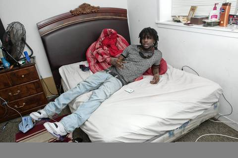 Sixteen-year-old Chicago rapper Chief Keef leans on his bed at home on the South Side of Chicago.