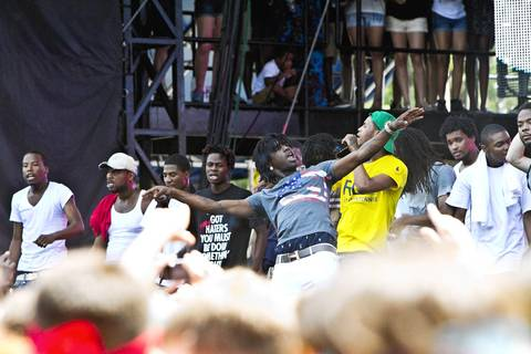 Chief Keef performs at Lollapalooza in Grant Park with fans gathering around him.