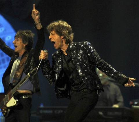 The Rollings Stones, including Ron Wood, left, and Mick Jagger, perform at the United Center in Chicago.