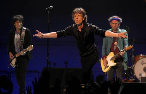 Mick Jagger, center, leads the Rollings Stones, including Ron Wood, left, and Keith Richards, at the United Center in Chicago.