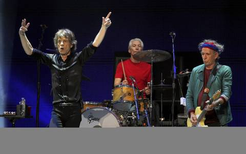 Mick Jagger, left, leads the Rollings Stones, including Charlie Watts, center, and Keith Richards, at the United Center in Chicago.