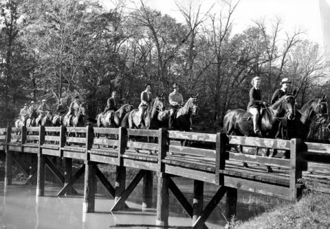Horsemen and horsewomen on October 11, 1941 cross a forest preserve bridge near Wilmette soon after their start on a two day pleasure ride to Algonquin and back. The group rode back to Harms Woods in Morton Grove, where the ride began.