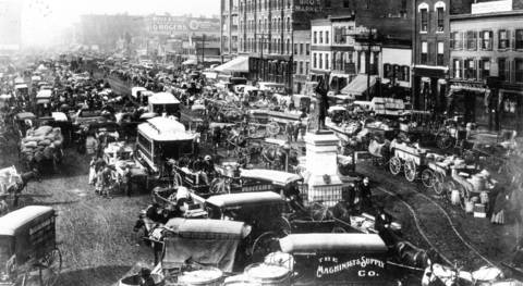 Randolph Street is choked with wagons, horse-drawn carts and people in Chicago in 1890.