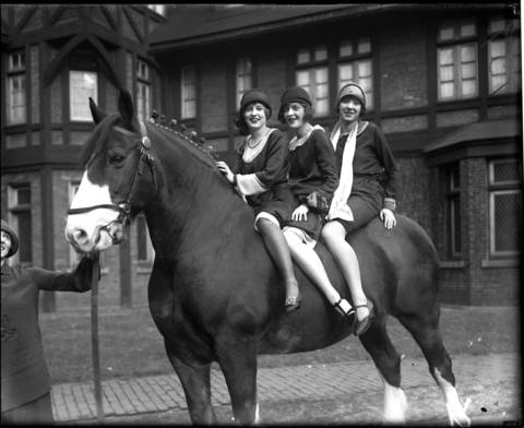 Marianna Meade, left, holds onto a horse as Helen Wilson, from left, Marjorie Phillips and Dorothy Rachavell ride on November 25, 1925, in Chicago.