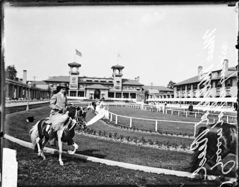 Mildred Reed rides a horse named Spotwood on a track at the South Shore Country Club in Chicago in 1913. The South Shore Club was a popular spot for horse shows and high society.