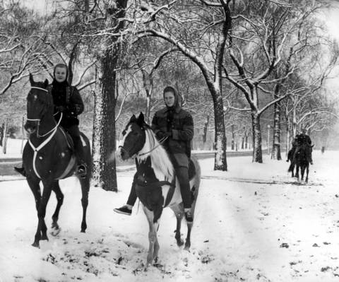 Renee Howard, left, and Stefany Weber enjoy horseback riding on snow covered trails in Lincoln Park on November 19, 1961, after the city and suburbs got the first white blanket of snow.