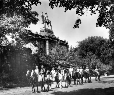Horseback riding was a familiar sight along the trails of the lake shore parks. A group of young riders enjoys a ride along a bridle path in a wooded area of Lincoln Park on August 10, 1962.