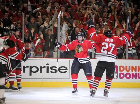 Blackhawks right wing Patrick Kane (center) celebrates his goal of the game in the third period.