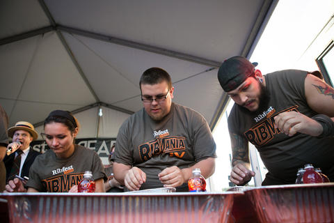Ribmania eating contest at Ribfest, held in Northcenter at the intersection of Lincoln Ave and Irving Park, photographed on Friday, June 7, 2013.