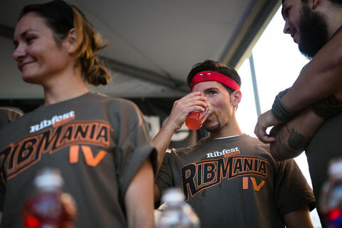 Ribmania eating contest at Ribfest, held in Northcenter at the intersection of Lincoln Ave and Irving Park, photographed on Friday, June 7, 2013. (Hilary Higgins/RedEye)