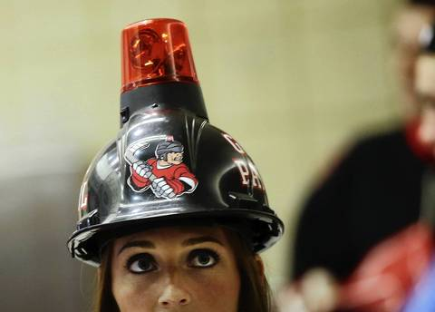 A Blackhawks fan with a goal light helmet at Game 5 of the Hawks-Kings playoffs at the United Center.