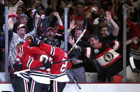 Blackhawks fans celebrate after a goal by center Marcus Kruger during Game 1 of the Hawks-Wings Western Conference semifinals at the United Center.
