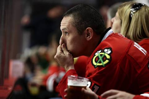 Blackhawks fan Brian Villafan, of Evergreen Park, reacts in the third period as the Detroit Red Wings surge ahead of the Chicago Blackhawks in Game 2 of the Western Conference Semifinals at the United Center.