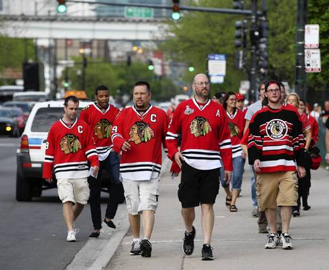 Blackhawks fans arrive at the United Center for Game 1 of the Western Conference Semifinals.