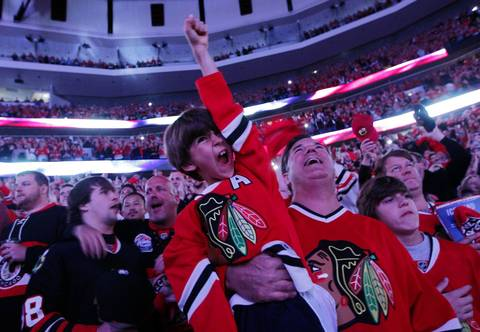 Blackhawks fans cheer during Game 5 of the Hawks-Kings playoffs at the United Center.