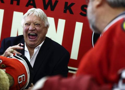 Blackhawks legend Bobby Hull signs autographs for fans before Game 1 of the Hawks-Kings Western Conference Finals at the United Center.