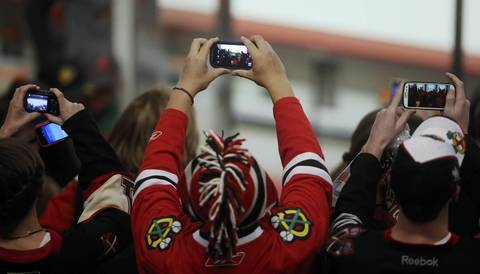 Fans hold up cameras waiting for the Blackhawks in Game 2 against the Kings in the Western Conference Finals at the United Center.