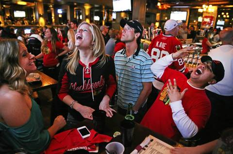 With an empty net in the final minute of Game 3 of the Stanley Cup Western Conference Finals against the Los Angeles Kings, Blackhawks fans Stephanie Abbinante, left, Trisha Nikrandt, Matt Cohen, and Abe Virella, react to a scoring chance by the Chicago Blackhawks. The group of friends watched the game at West End in Chicago.