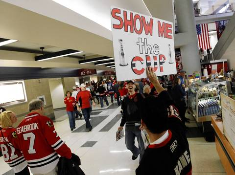 Blackhawks fans arrive before Game 5 of the Hawks-Kings playoffs at the United Center.