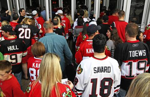 Blackhawks fans make their way into the United Center for Game 5 of the Hawks-Kings playoffs.