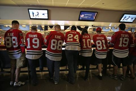Blackhawks fans line up early in the standing room only section before Game 1 of the Hawks-Wings NHL Western Conference Semifinals at the United Center.