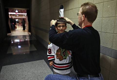 Blackhawks fan Dave Milen readies his son Christopher Milen, five before Game 5 of the Hawks-Wings NHL Western Conference Semifinals at the United Center.