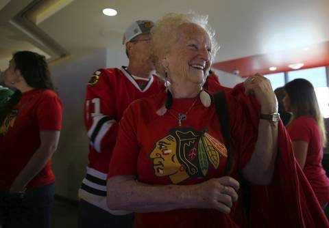 Blackhawks fan Helen Barnes of Lima, Ohio arrives to claim her standing room only spot before Game 1 of the Hawks-Wings NHL Western Conference Semifinals at the United Center.