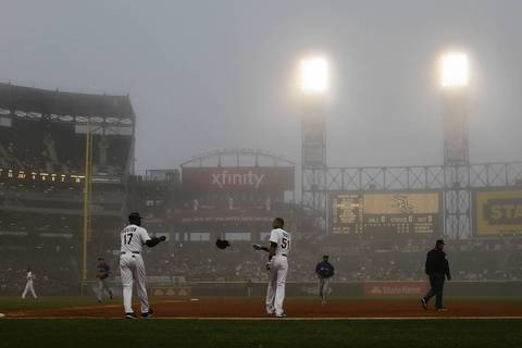 Chicago White Sox' Alex Rios makes the final out of 2nd inning as fog rolls in during game against Toronto Blue Jays during MLB game at U.S. Cellular Field in Chicago.