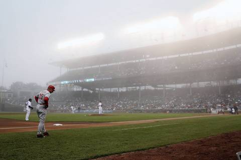 Fog rolls into Wrigley Field during the first inning between the Chicago Cubs and the Cincinnati Reds.