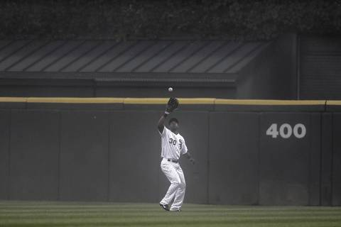 Chicago White Sox' Alejandro De Aza catches Toronto Blue Jays' Josh Thole's fly out with the bases loaded to end top of third inning at U.S. Cellular Field.