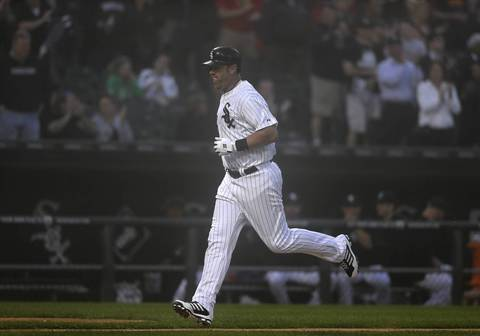 Chicago White Sox' Adam Dunn hits home run in the third inning against Toronto Blue Jays' RA Dickey during their game at U.S. Cellular Field.