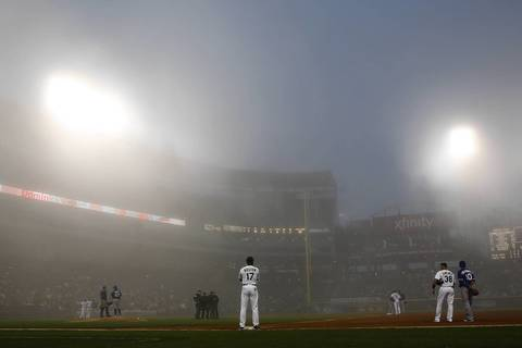 Chicago White Sox' first base coach Daryl Boston watches as the umpire crew decides on whether to call a fog delay during third inning of Sox' game against the Toronto Blue Jays at U.S. Cellular Field.