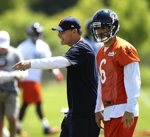 Bears head coach Marc Trestman works with Jay Cutler.