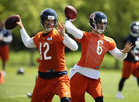 Josh McCown (12) and Jay Cutler (6) warm up.