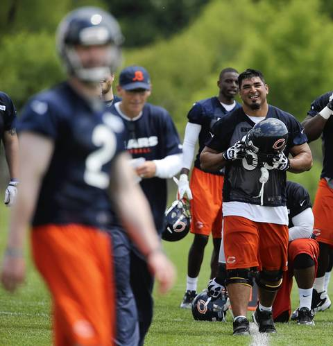 Roberto Garza (far right) and the rest of the team get ready to take the field.