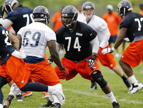Bears tackle Jermon Bushrod (74) blocks during drills.
