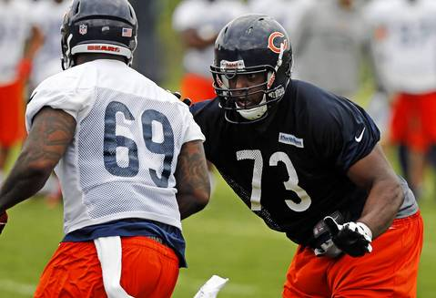 Bears offensive tackle J'Marcus Webb (73) blocks defensive tackle Henry Melton (69) during drills.