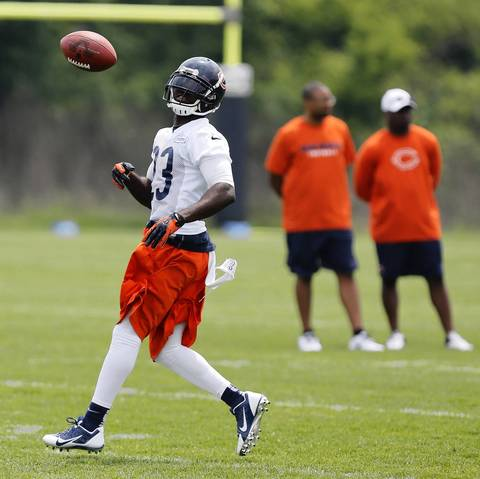 Devin Hester tosses a ball during a special teams drill.