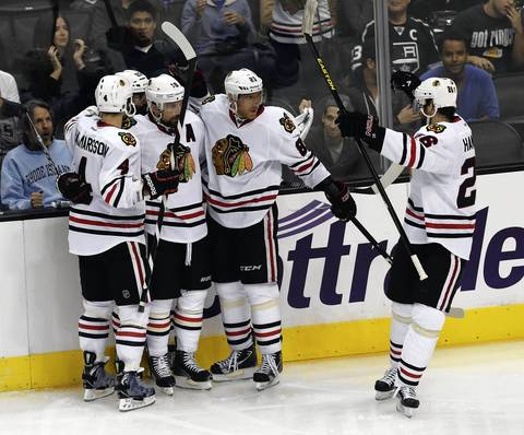 Marian Hossa, third from left, celebrates his go-ahead goal with Niklas Hjalmarsson, Patrick Sharp and Michal Handzus.
