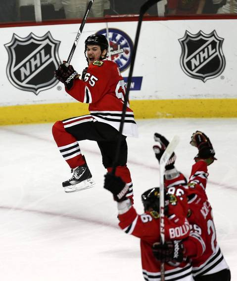 Andrew Shaw celebrates his game-winning goal in the third overtime against the Bruins in Game 1.