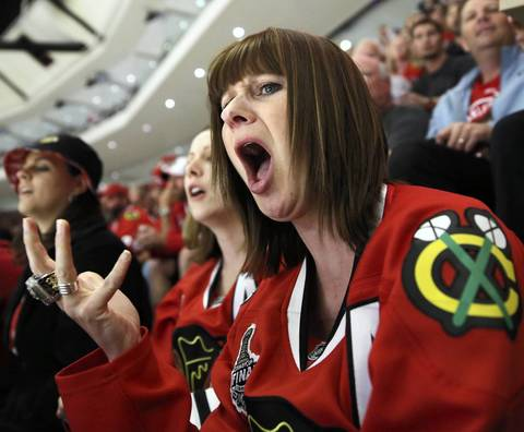 Blackhawks fan Trisha Ithal reacts to a referee's call in the second period.