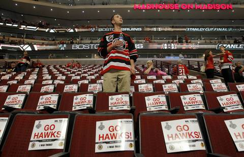 Alex Okoskey finds his seat before Game 1.