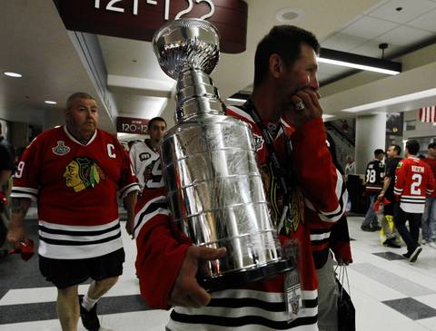 Fans carry a replica Stanley Cup.