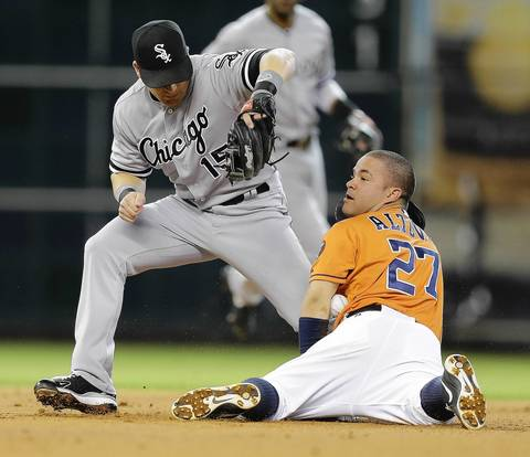 The Astros' Jose Altuve steals second base as Gordon Beckham loses the ball in the first inning.