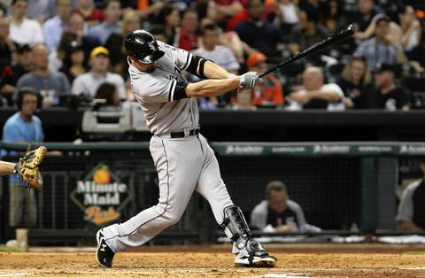 Paul Konerko hits a double during the fourth inning.