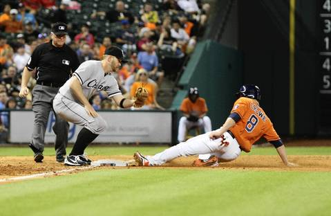The Astros' Trevor Crowe steals third base as Jeff Keppinger attempts to apply the tag during the seventh inning.