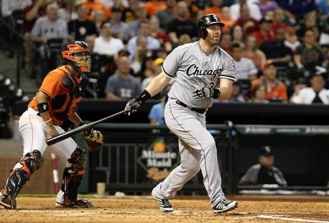 Adam Dunn drives in a run with a sacrifice fly during the fourth inning.